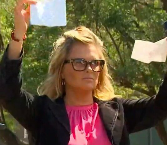 Dallas salon owner reopens business despite stay-at-home order, rips up citation during rally